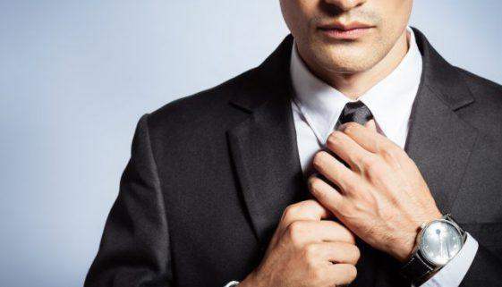 Man in suit fixing his tie